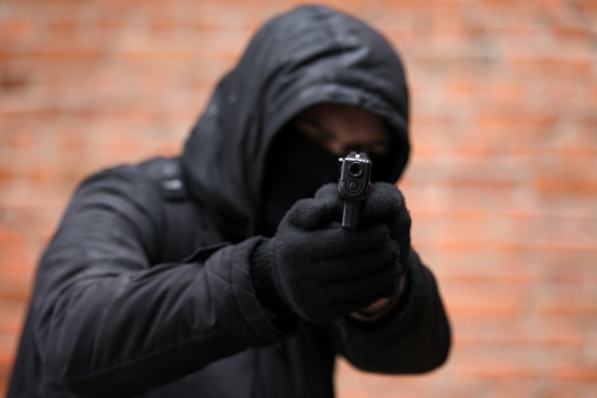 Man in black mask with handgun